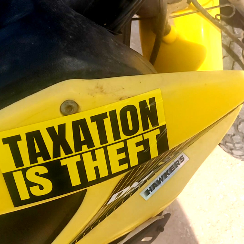 taxation is theft sticker on a motorcycle